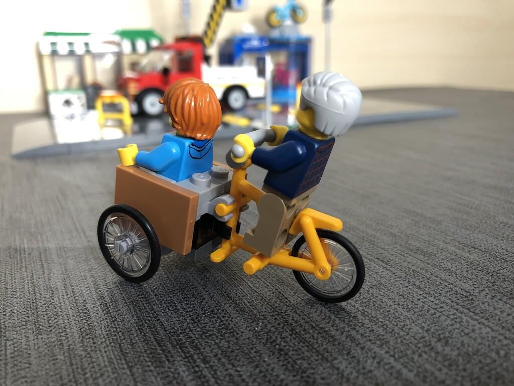 Lastenrad mit Fahrern